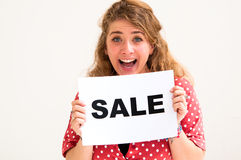 Young woman with board sale Stock Images