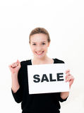 Young woman with board sale Royalty Free Stock Photography