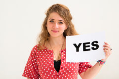 Young woman with board yes Royalty Free Stock Photos