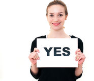 Young woman with board yes Stock Photography