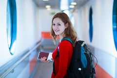 Young woman  boarding an aircraft Royalty Free Stock Photo