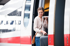 Young woman boarding a train Royalty Free Stock Photos