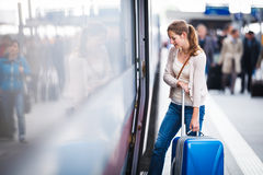 Young woman boarding a train Stock Photos