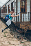 Young woman boarding a train Royalty Free Stock Photography