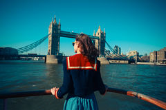 Young woman on boat looking at Tower Bridge royalty free stock photo