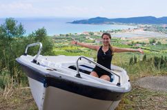Young woman in the boat, Zakynthos, Greece Stock Photo