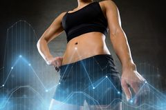 Young woman body in gym Stock Photography
