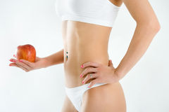 Young woman body and hand holding orange Royalty Free Stock Photo