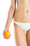 Young woman body and hand holding orange Stock Image
