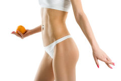 Young woman body and hand holding orange Royalty Free Stock Photos