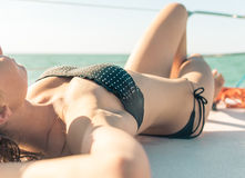 Young woman body lying on the boat deck Stock Image