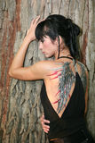 Young woman with body painting. Young woman with painted wings on her back stock photography