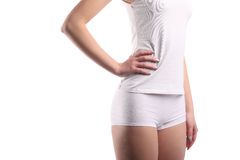 Young woman body with white cotton panties and shirt isolated on white Royalty Free Stock Photos