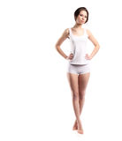 Young woman body with white cotton panties and shirt isolated on white, hands on waist, full high Royalty Free Stock Image