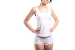 Young woman body with white cotton panties and shirt isolated on white, hands on waist, unrecognizable Stock Photography