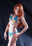 Young woman bodybuilder in bikini Royalty Free Stock Images
