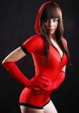 Young woman in the bodysuit with a hood. Royalty Free Stock Image
