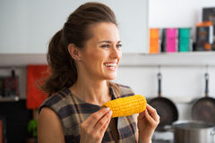 Young woman with boiled corn Royalty Free Stock Photo