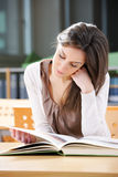Young woman with book Royalty Free Stock Photography