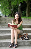Young woman with a book Stock Images