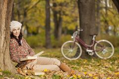 Young woman with book Royalty Free Stock Images