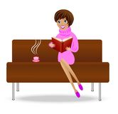Young woman with book and cup of tea sit on sofa Royalty Free Stock Photo