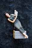 Young woman with book on the floor Stock Image