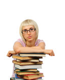 Young woman with book heap Stock Photos