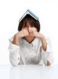 Young woman with book on her head. On white background royalty free stock image