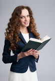 Young woman with a book Royalty Free Stock Photography