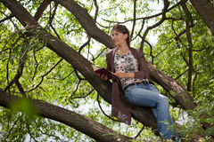 Young woman with the book in the park. Royalty Free Stock Image