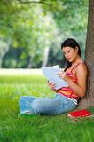 Woman in park. Young woman with book in park Stock Photo
