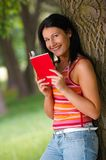 Woman in park. Young woman with book in park Stock Images