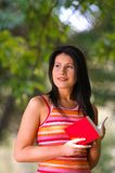 Woman in park. Young woman with book in park Royalty Free Stock Photography
