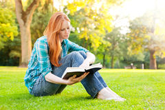 A Young Woman with a Book Royalty Free Stock Images
