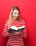 Young woman with a book Stock Photos