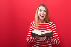 Young woman with a book Stock Photo