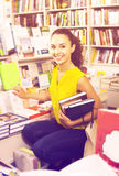 Young woman in book shop Stock Images