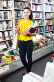 Young woman in book shop Royalty Free Stock Photography