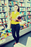 Young woman in book shop Royalty Free Stock Photos