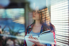 Young woman with a book Stock Image