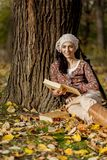 Young woman with books. In the autumn forest Stock Photo
