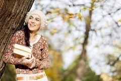 Young woman with books. Happy young woman with books in the forest Stock Images