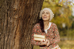 Young woman with books at the autumn forest Stock Image