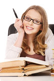 Young woman with a books pile Royalty Free Stock Photos