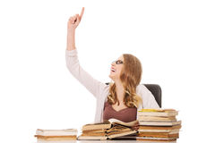 Young woman with books pile pointing up Stock Photo