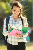 Young woman with books Royalty Free Stock Photography