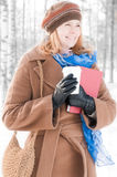 Young woman with books in winter Royalty Free Stock Photo