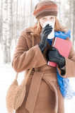 Young woman with books in winter Royalty Free Stock Image