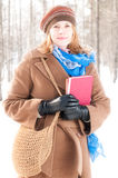 Young woman with books in winter Royalty Free Stock Photos